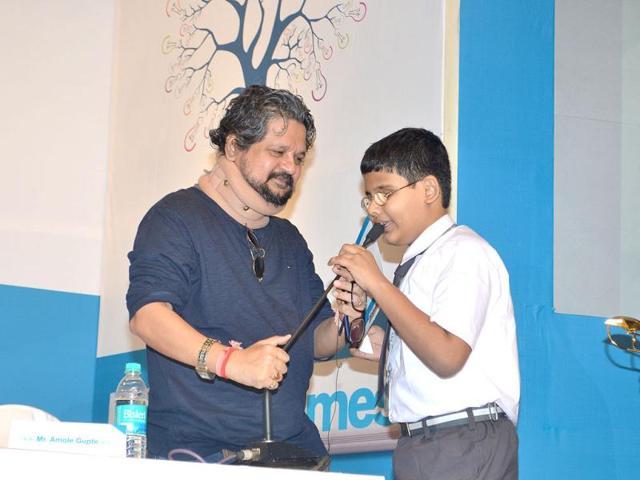 Director-Amol-Gupte-with-a-student-at-Hindustan-Times-Scholarship-awards-ceremony-2012--in-Mumbai-HT-Photo-Prodip-Guha