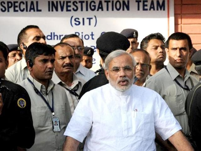 File-photo-of-Gujarat-chief-minister-Narendra-Modi-C-as-he-speaks-to-journalists-after-appearing-before-the-Supreme-Court-appointed-Special-Investigation-Team-in-Gandhinagar-on-March-27-2010-AFP-Photo-Sam-Panthaky