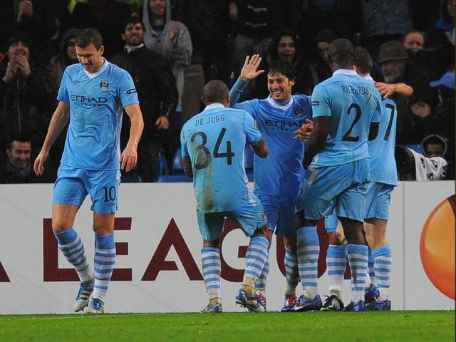 Manchester-City-midfielder-David-Silva-3rd-R-celebrates-after-scoring-a-goal-during-the-UEFA-Europa-League-round-of-32-second-leg-football-match-against-FC-Porto-at-the-Etihad-stadium-in-Manchester-AFP-Photo-Andrew-Yates