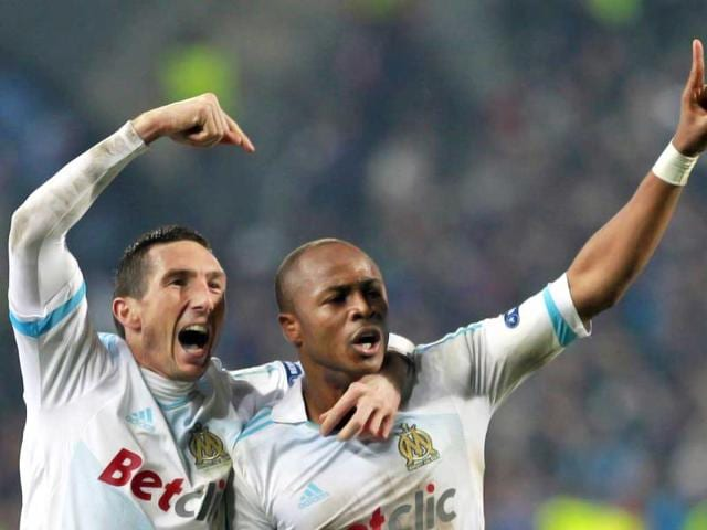 Olympic-Marseille-s-Andre-Ayew-R-celebrates-with-teammate-Morgan-Amalfitano-after-scoring-against-Inter-Milan-during-their-Champions-League-soccer-match-at-the-Velodrome-stadium-in-Marseille-Reuters-Eric-Gaillard