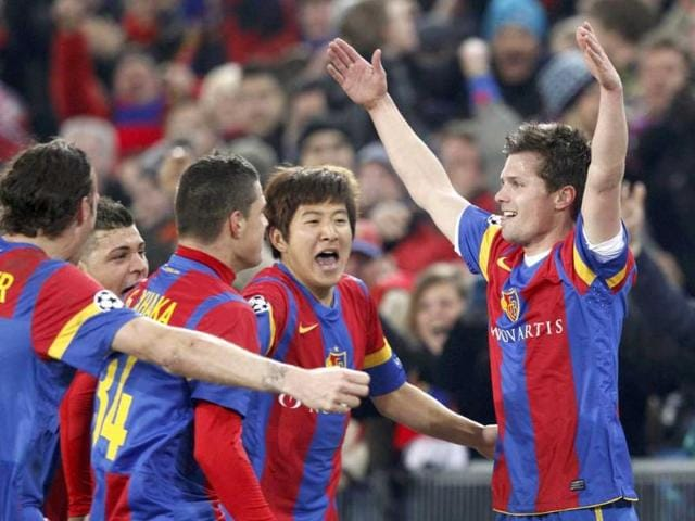 FC-Basel-s-Valentin-Stocker-R-celebrates-with-team-mates-after-he-scored-the-first-goal-for-the-team-during-their-Champions-League-last-16-first-leg-soccer-match-against-Bayern-Munich-in-Basel-Reuters-Michael-Buholzer