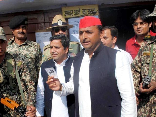 Samajwadi-Party-Uttar-Pradesh-unit-president-Akhilesh-Yadav-showing-his-voter-identity-card-outside-poll-booth-Agencies-Photo