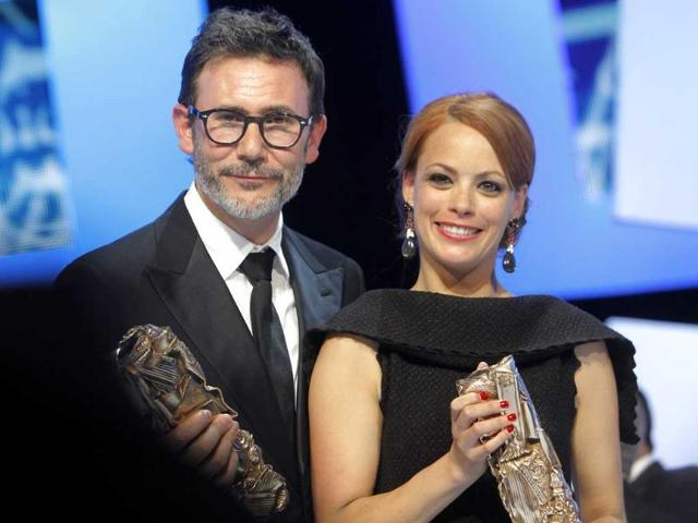 Film-director-Michel-Hazanavicius-poses-with-actress-Berenice-Bejo-on-the-stage-after-his-film-The-Artist-was-awarded-the-Best-Movie-Cesar-and-Best-Actress-duirng-the-37th-Cesar-Film-Awards-at-Theatre-du-Chatelet-AP-Photo-Jacques-Brinon