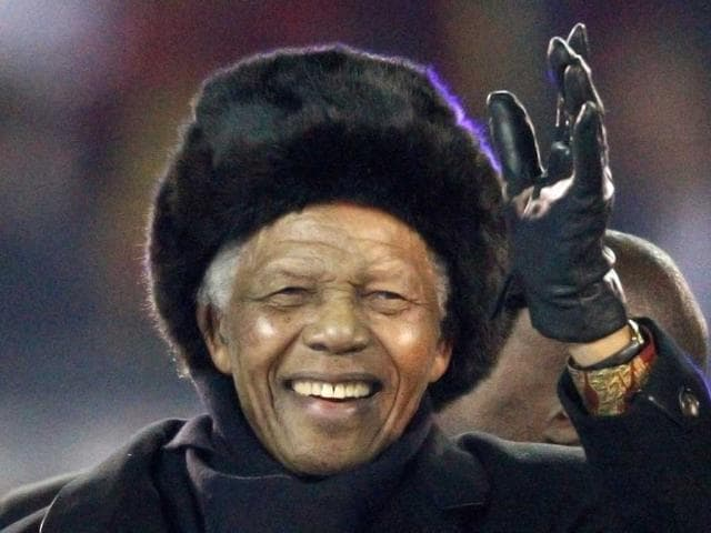 Former South African President Nelson Mandela waves to the crowd at Soccer City stadium during the closing ceremony for the 2010 World Cup in Johannesburg July 11, 2010. Reuters/Michael Kooren