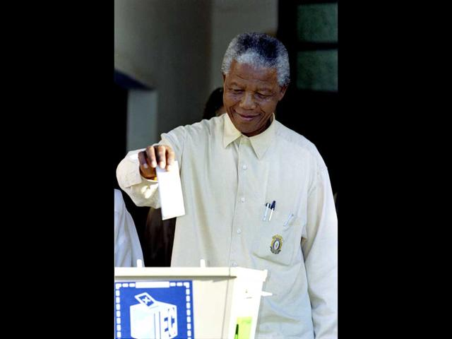 African National Congress (ANC) president Nelson Mandela casts his ballot at Ohlange High school in Inanda near Durban in 1994 during South Africa