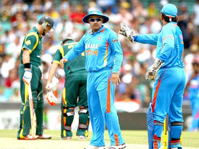 MS-Dhoni-R-and-teammate-Virender-Sehwag-discuss-fielding-options-while-playing-against-Australia-in-their-one-day-international-cricket-match-in-Sydney-AP-Photo-Rick-Rycroft