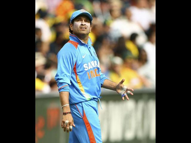 Sachin-Tendulkar-looks-up-as-he-positions-himself-for-fielding-while-playing-against-Australia-in-their-one-day-international-cricket-match-in-Sydney-AP-Photo-Rick-Rycroft