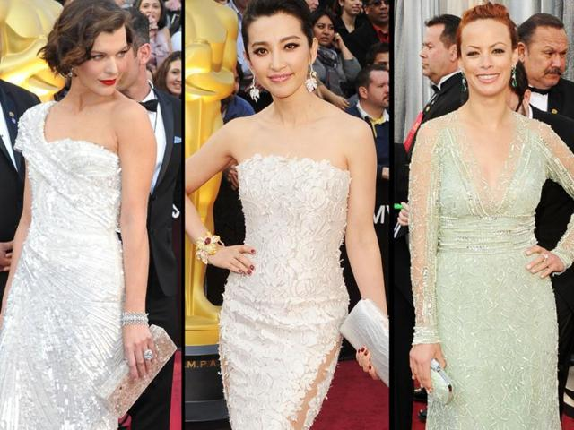 From-Left-to-right-Milla-Jovovich-Bingbing-Li-and-Berenice-Bejo-arrive-on-the-red-carpet-for-the-84th-Annual-Academy-Awards