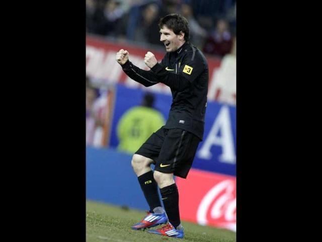 FC-Barcelona-s-Lionel-Messi-from-Argentina-celebrates-after-scoring-during-a-Spanish-La-Liga-soccer-match-at-the-Vicente-Calderon-Stadium-in-Madrid-AP-Photo-Alberto-Di-Lolli