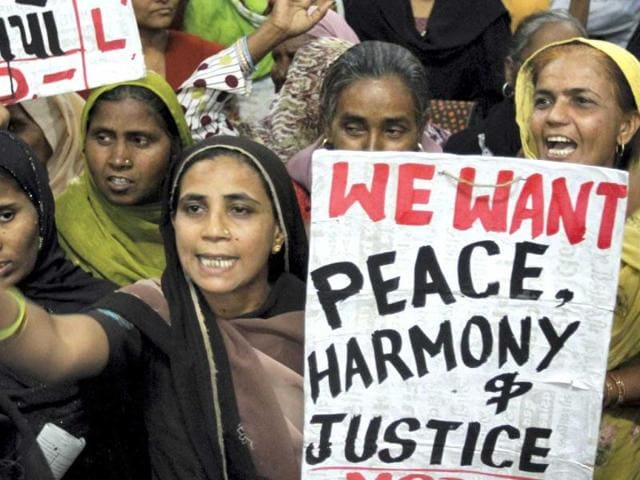 A-Muslim-woman-holds-a-placard-as-she-participates-in-a-citizens-convention-to-mark-the-10th-anniversary-of-the-Gujarat-riots-in-Ahmedabad-AP-Images