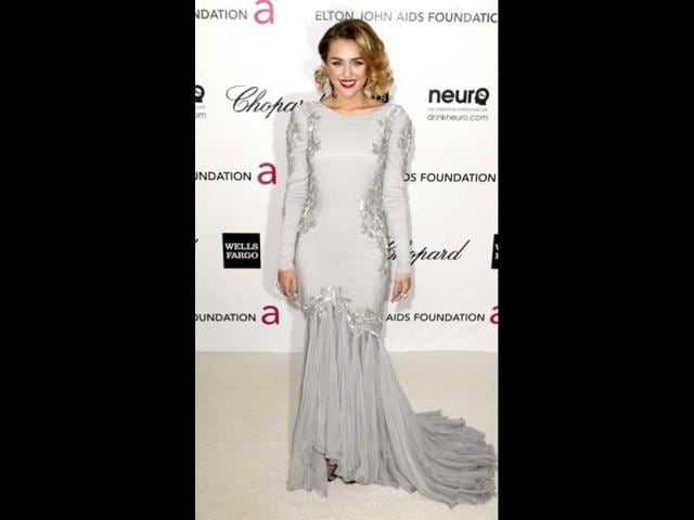 Miley-Cyrus-looks-average-in-a-grey-gown-Photo-AFP