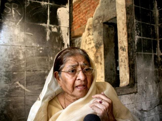 Zakia-Jafari-wife-of-2002-post-Godhra-riots-victim-Ehsaan-Jafari-visits-her-old-house-at-Gulbarg-Society-on-the-10th-anniversary-of-the-carnage-in-Ahmedabad-PTI-photo