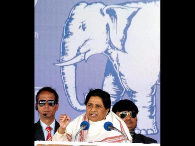 Uttar-Pradesh-chief-minister-Mayawati-poses-with-her-voter-identity-card-and-ink-marked-finger-after-casting-her-vote-in-Lucknow-AFP-Photo