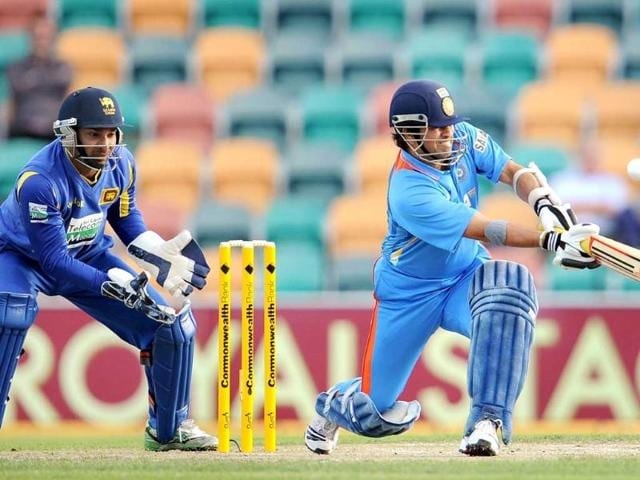 Sachin-Tendulkar-R-hits-out-at-the-bowling-at-Sri-Lankan-wicketkeeper-Kumar-Sangakkara-L-looks-on-in-their-international-one-day-cricket-match-played-in-Hobart-AFP-Photo-William-West