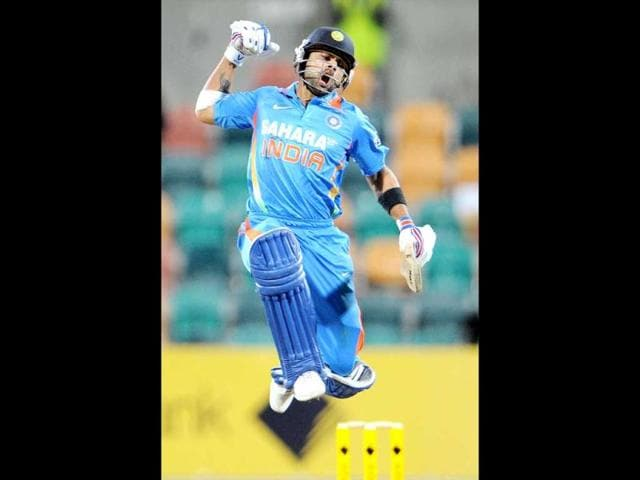 Indian-batsman-Virat-Kohli-leaps-in-the-air-after-scoring-his-century-against-Sri-Lanka-in-their-international-one-day-cricket-match-played-in-Hobart-AFP-Photo-William-West