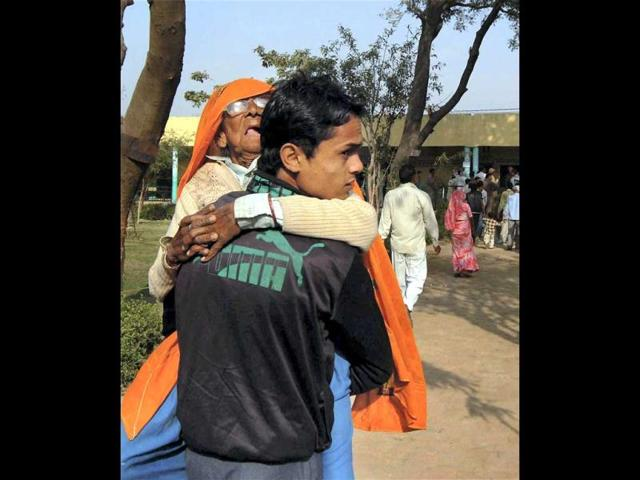 -An-elderly-voter-is-carried-to-a-polling-booth-during-sixth-phase-of-Uttar-Pradesh-assembly-elections-in-Noida-on-Tuesday-PTI-Photo