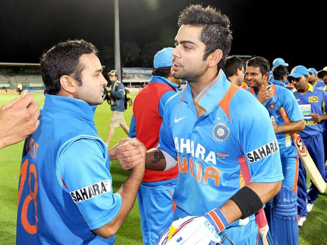 Virat-Kohli-L-is-congratulated-by-teammate-Suresh-Raina-after-hitting-the-winning-runs-against-Sri-Lanka-in-their-international-one-day-cricket-match-played-in-Hobart-AFP-William-West