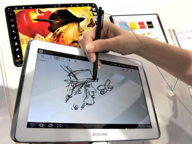 A-tablet-for-those-who-love-to-draw-and-take-notes-with-a-stylus-Samsung-has-taken-its-tablet-smartphone-hybrid-Galaxy-Note-and-turned-it-into-a-10-1-tablet-that-works-in-conjunction-with-a-stylus-The-Galaxy-Note-10-1-can-be-used-with-your-finger-or-with-an-advanced-pen-input-called-the-S-Pen-Photos-credit-AFP-PHOTO-LLUIS-GENE
