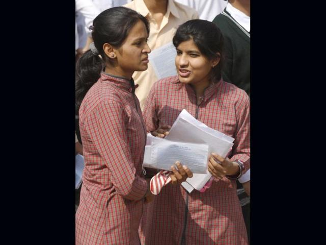 12th-standard-students-give-a-last-look-to-their-notes-as-they-prepare-to-appear-in-their-CBSE-exams-at-an-examination-centre-in-Moradabad--PTI-Photo