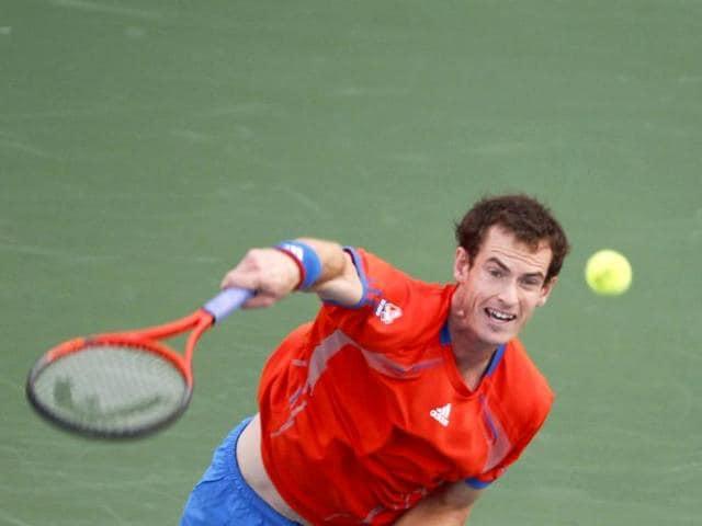 Andy-Murray-of-Britain-serves-to-Novak-Djokovic-of-Serbia-during-their-semifinal-match-at-the-Dubai-Tennis-Championships-Reuters-Jumana-El-Heloueh
