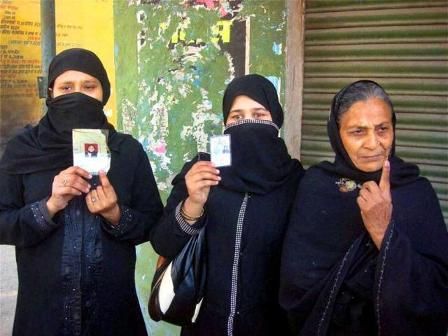 Burqa-clad-voters-after-casting-their-votes-at-a-polling-station-during-the-final-phase-of-Uttar-Pradesh-assembly-elections-in-Rampur-PTI-Photo