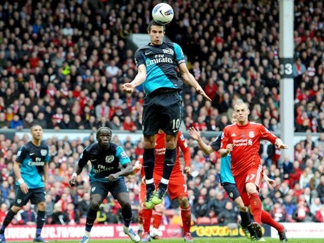 Arsenal-s-Dutch-striker-Robin-van-Persie-C-jumps-for-the-ball-during-the-English-Premier-League-football-match-between-Liverpool-and-Arsenal-at-Anfield-in-Liverpool-north-west-England-AFP-Photo