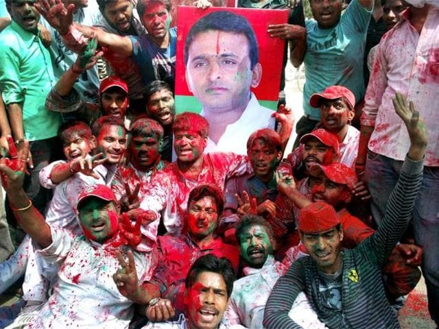 Samajwadi-Party-workers-celebrate-with-a-poster-of-Akhilesh-Yadav-in-Allahabad-PTI
