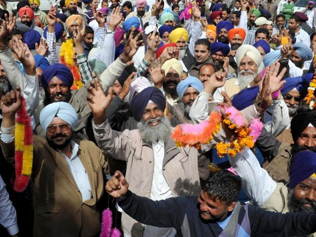 Supporters-of-the-Shiromani-Akali-Dal-and-Bharatiya-Janata-Party-alliance-celebrate-after-the-announcement-of-results-in-their-favour-outside-the-counting-centre-in-Amritsar-AFP-Photo-Narinder-Nanu
