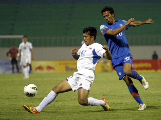India-s-Sushil-Kumar-Singh-right-fights-for-a-ball-with-Philippines-Jason-Abbott-Sabio-during-their-AFC-Challenge-Cup-soccer-tournament-in-Kathmandu-Nepal-Philippines-won-the-match-2-0-AP-Binod-Joshi