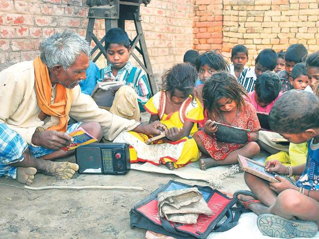 Students-poring-over-their-slates-in-Banwasi-s-left-school-Though-the-school-is-upto-Class-3-Banwasi-supervises-their-studies-even-beyond