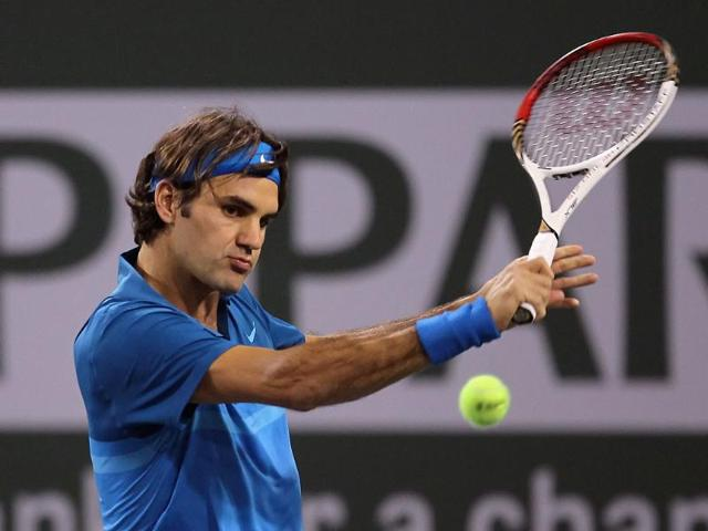 Roger-Federer-of-Switzerland-returns-a-backhand-to-Denis-Kudla-during-the-BNP-Paribas-Open-at-the-Indian-Wells-Tennis-Garden-in-Indian-Wells-California-AFP-Photo