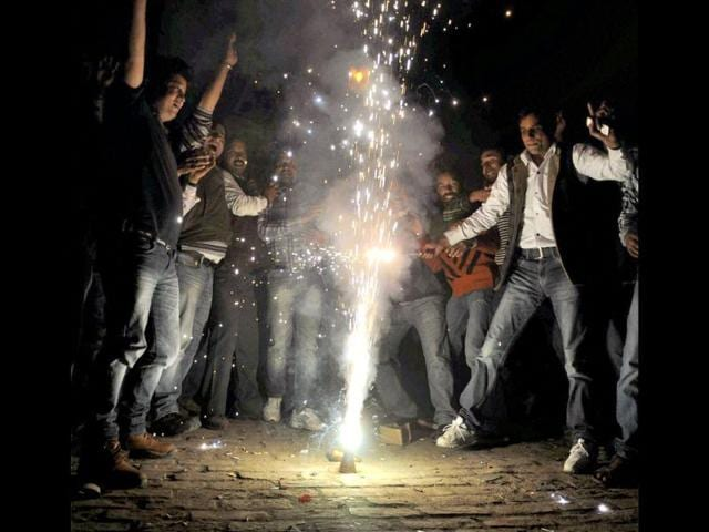 Supporters-of-MP-from-Tehri-Garhwal-Vijay-Bahuguna-light-fire-crackers-to-celebrate-the-news-of-him-becoming-the-next-chief-minister-of-Uttarakhand-in-Dehradun-PTI-photo