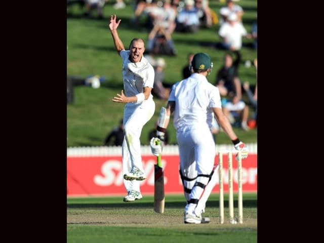 New-Zealand-s-Chris-Martin-L-successfully-appeals-the-wicket-of-South-Africa-s-Dale-Steyn-caught-by-Kruger-van-Wyk-for-4-on-the-first-day-of-the-second-International-Cricket-Test-at-Seddon-Park-in-Hamilton-New-Zealand-AP-Photo-SNPA-Ross-Setford