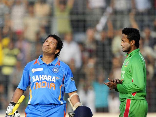 Sachin-Tendulkar-reacts-after-scoring-his-hundred-century-100-runs-as-he-is-watched-by-Bangladeshi-cricketer-Shakib-Al-Hasan-during-the-ODI-Asia-Cup-cricket-match-between-India-and-Bangladesh-at-the-Sher-e-Bangla-National-Cricket-Stadium-in-Dhaka-AFP-PHOTO-Munir-uz-Zaman