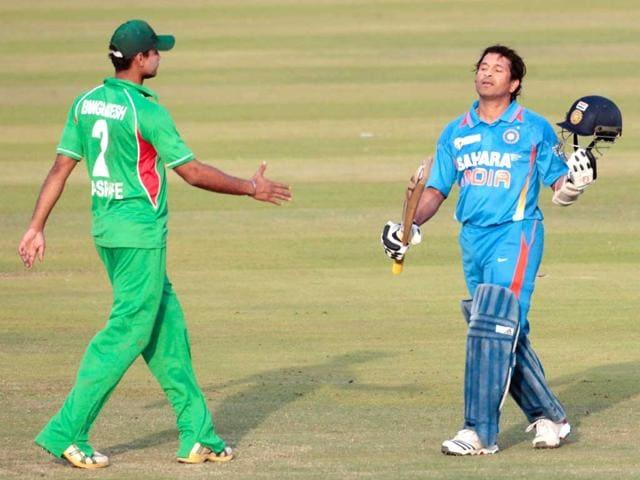 Bangladesh-s-Masrafe-Bin-Mortaza-L-congratulates-Sachin-Tendulkar-after-he-scored-his-100th-century-during-their-One-Day-International-ODI-in-Dhaka-Reuters