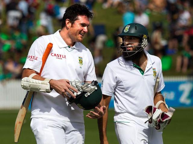 Hashim-Amla-R-speaks-with-Graeme-Smith-after-South-Africa-beat-New-Zealand-during-day-three-of-the-cricket-Test-match-at-Seddon-Park-in-Hamilton-AFP-Marty-Melville