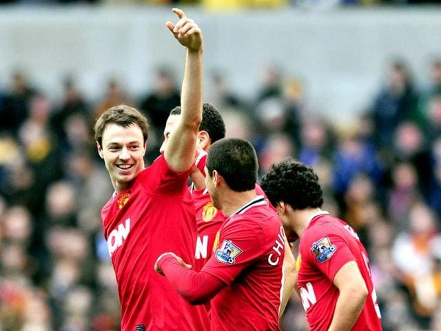Manchester-United-s-defender-Jonny-Evans-celebrates-scoring-a-goal-during-their-English-Premier-League-football-match-against-Wolverhampton-Wanderers-at-Molineux-Stadium-in-Wolverhampton-AFP-Photo-Glyn-Kirk