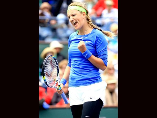 Victoria-Azarenka-of-Belarus-poses-for-photographers-with-the-winner-s-trophy-after-defeating-Maria-Sharapova-of-Russia-during-the-final-of-the-BNP-Paribas-Open-at-the-Indian-Wells-Tennis-Garden-in-Indian-Wells-California-AFP-Matthew-Stockman
