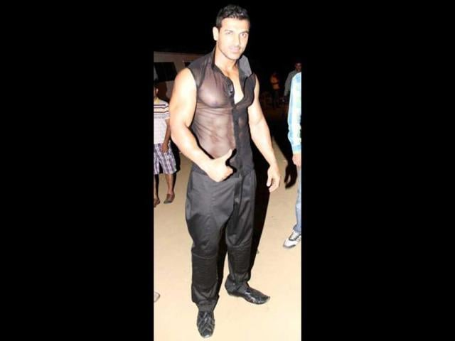The 39-year-old actor flaunts his chiselled body in a sheer black sleeveless shirt.