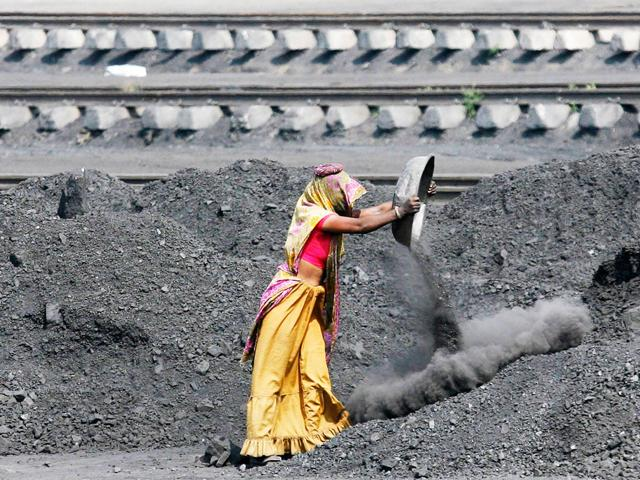 File-photo-A-labourer-works-inside-a-coal-yard-on-the-outskirts-of-Ahmedabad-Reuters