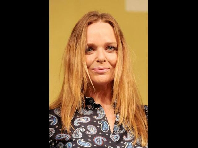 British-designer-Stella-McCartney-poses-for-photographers-during-the-unveiling-of-the-new-British-Olympic-Team-GB-kit-she-designed-in-central-London-AFP-PHOTO-CARL-COURT