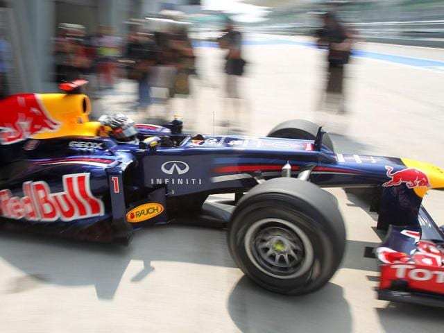 Red-Bull-Formula-One-driver-Sebastian-Vettel-of-Germany-drives-out-of-his-pit-lane-garage-during-the-first-practice-session-at-the-Malaysian-Formula-One-Grand-Prix-at-Sepang-Malaysia-AP-Photo-Dita-Alangkara