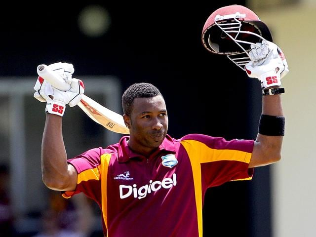 West-Indies-batsman-Kieron-Pollard-raises-his-bat-and-helmet-after-reaching-a-century-during-the-fourth-one-day-international-cricket-match-against-Australia-in-Gros-Islet-St-Lucia-The-West-Indies-won-the-match-AP-Photo-Andres-Leighton