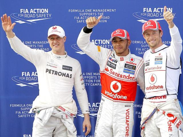 McLaren-locked-out-the-front-row-of-the-starting-grid-for-the-second-race-in-a-row-as-Michael-Schumacher-right-was-amongst-the-three-fastest-qualifiers-for-the-first-time-since-2004-in-Malaysian-Grand-Prix-practice-session-AP-Photo