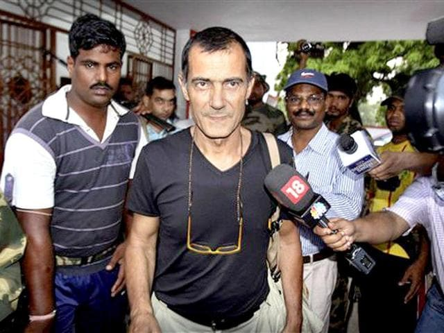 Italian-tourist-Claudio-Colangelo-walks-with-the-media-people-after-he-was-handed-over-by-the-Maoists-to-a-TV-crew-at-Sorada-village-in-Ganjam-district-Odisha-AP-Photo-Biswaranjan-Rout