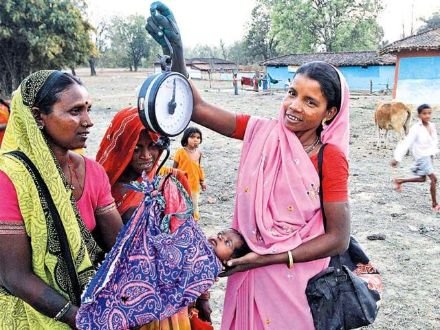 Rambai-right-a-Mitanin-weighing-a-healthy-newborn-in-Rokra-hamlet-Chhattisgarh-To-mothers-in-rural-areas-she-is-a-godsend-Virendra-Singh-Gosain-HT-Photo-