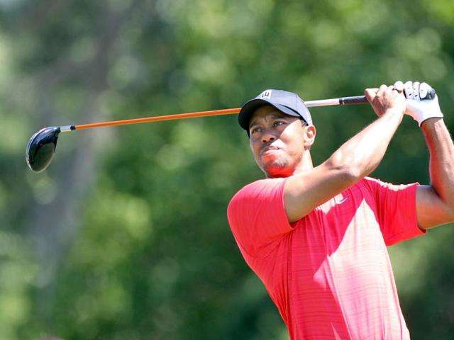 Tiger-Woods-plays-a-shot-on-the-4th-hole-during-the-final-round-of-the-Arnold-Palmer-Invitational-presented-by-MasterCard-at-the-Bay-Hill-Club-and-Lodge-in-Orlando-Florida-Sam-Greenwood-Getty-Images-AFP