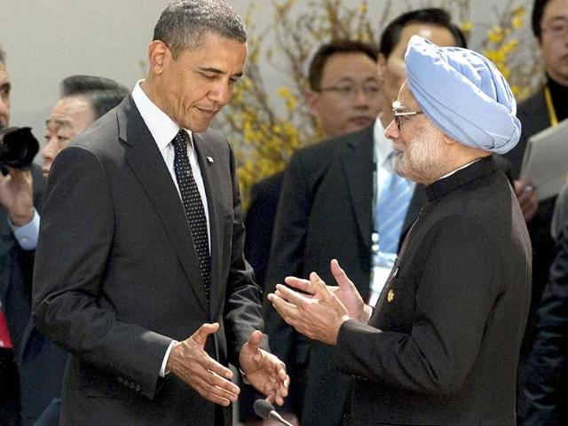 US-President-Barack-Obama-L-listens-to-Prime-Minister-Manmohan-Singh-before-the-start-of-the-2012-Seoul-Nuclear-Security-Summit-working-dinner-at-the-Coex-Center-in-Seoul-AFP-Photo