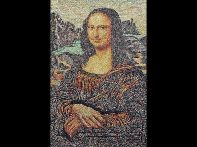 A-Mona-Lisa-replica-made-from-thousands-of-gems-is-seen-on-display-at-a-shopping-mall-in-Shenyang-Liaoning-province-The-total-weight-of-the-gems-on-the-art-piece-is-over-100-000-carats-local-media-reported-Reuters