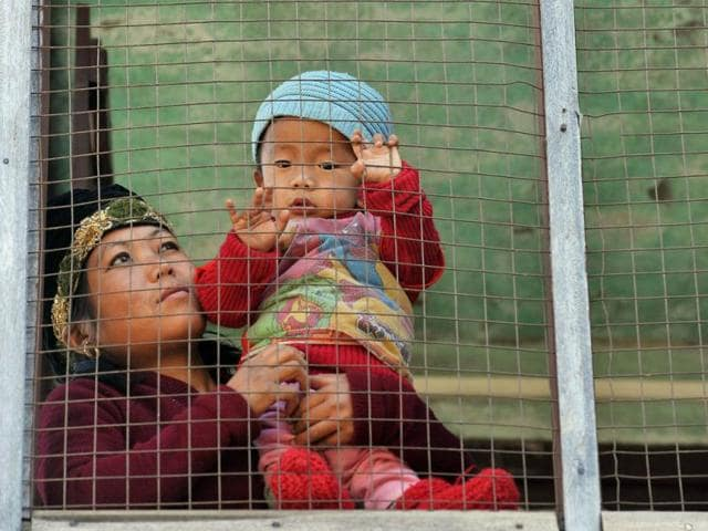 A-woman-carries-her-child-near-the-local-Bnei-Menashe-community-at-Shavai-Israel-Hebrew-Centre-which-houses-the-Beith-Shalom-Synagogue-in-Churachandpur-district-of-Manipur-AFP-Manjunath-Kiran